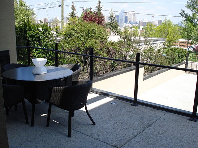 Custom Glass Top Railing System With Black Banister | Mountain View Sun Decks