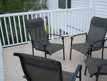 Second Floor Sun Deck With White Aluminum Railing Furnished With Chairs | Mountain View Sun Decks