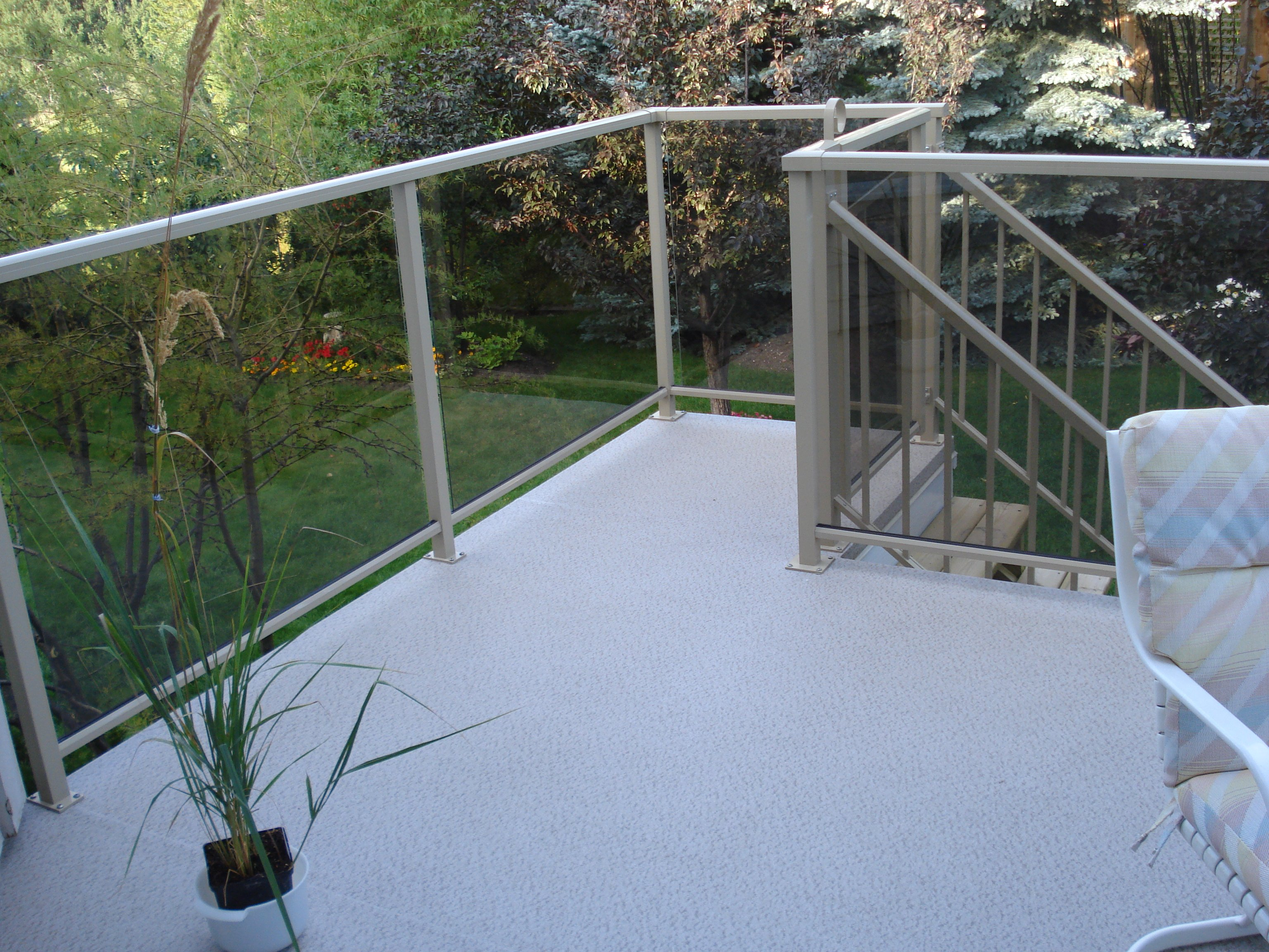 Grey And White Sun Deck With Clear Glass Railings | Mountain View Sun Decks