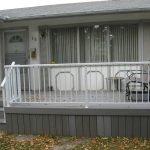 Grey Wooden Sun Deck With White Bar Railing   Mountain View Sun Decks
