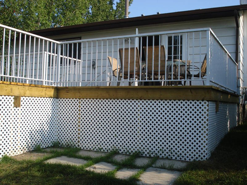 Raised Wooden Sun Deck With White Aluminum Railing